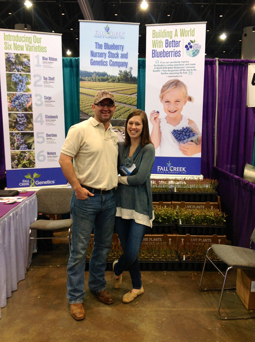 Fall Creek's Winn Morgan and his wife, Camille, pose in the booth at the SE Fruit & Vegetable Conference!